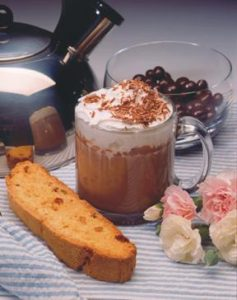 cup of hot cocoa with whipped cream and biscotti